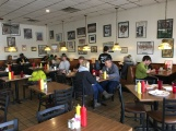 Sparty's Coney Island Restaurant creates a local, family diner feel with MSU and nostalgic sports posters. It honors the traditional coney island restaurants in Flint and Detroit. Photo by Alexa Seeger.