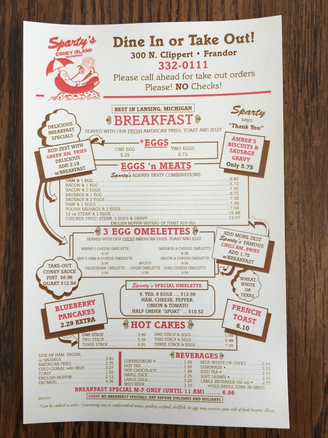 Sparty's Coney Island Restaurant offered a take-home menu. It is a half page and features dine in and take out options. Photo by Alexa Seeger.