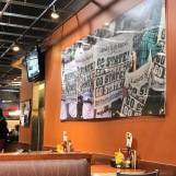 "Décor inside of Leo's Coney Island entertains the classic American diner theme feel with local touches of MSU. A large mural across the wall includes fans at a game holding up newspapers that read ""Go State."" Photo by Erika Greco."